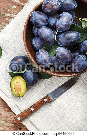 ripe plums in a plate - csp66460628