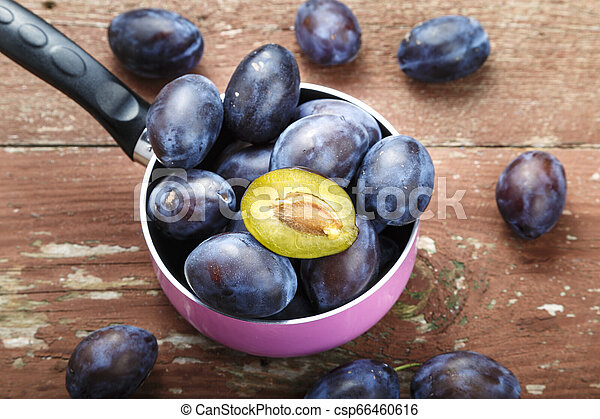 ripe plums on the table - csp66460616
