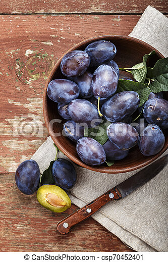 ripe plums on the table. - csp70452401