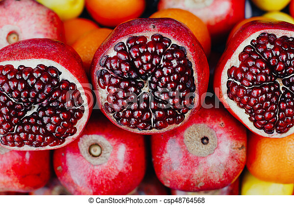 Ripe pomegranate fruits on the market counter - csp48764568