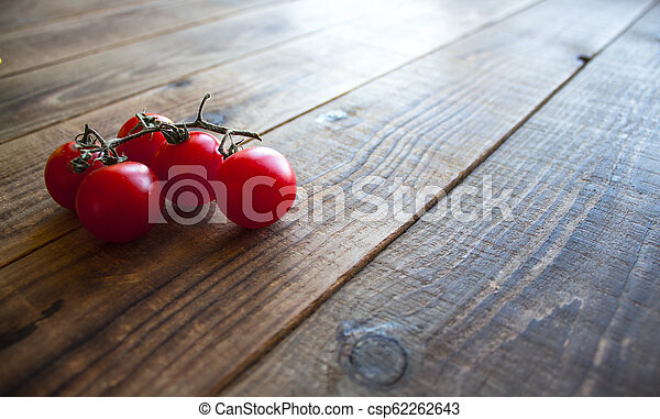 ripe tomatoes on a branch - csp62262643