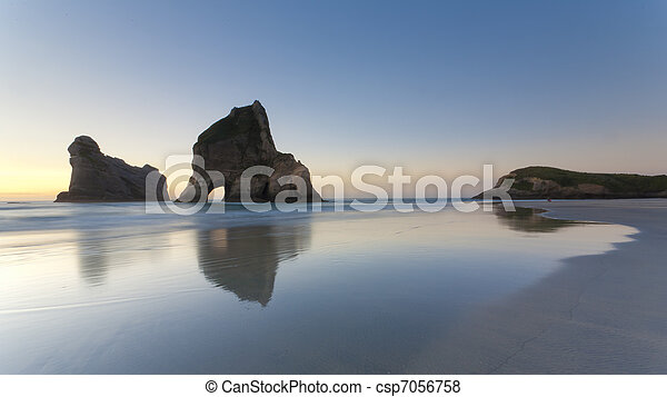 Rippled Sand and rock formations at Wharariki Beach, Nelson, North Island, New Zealand - csp7056758