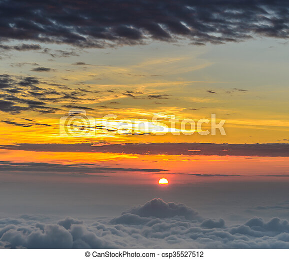 Rising sun in the early morning over sea of mist - csp35527512