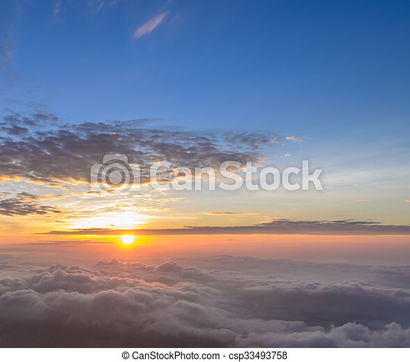 Rising sun in the early morning over sea of mist - csp33493758
