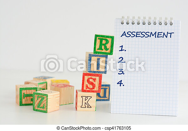 Risk concept with wooden pieces of a game forming the word Risk - csp41763105