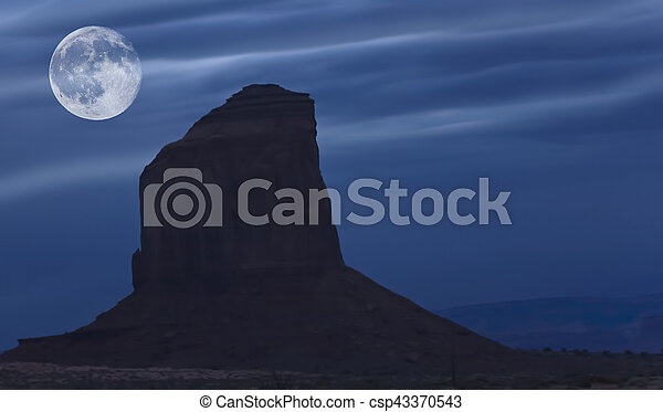 Risng moon over Monument Valley - csp43370543