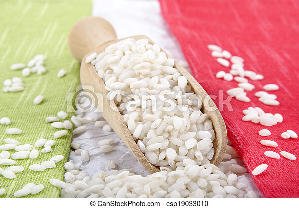 risotto rice on a wooden shovel - csp19033010