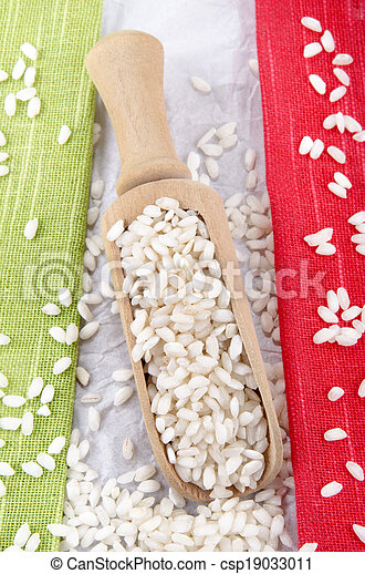risotto rice on a wooden shovel - csp19033011