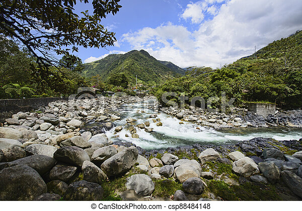 River at the Pailon Del Diablo waterfall, Banos de Agua Santa, Ecuador - csp88484148