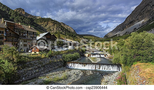 River fall at Cervieres village, Alps mountains, France - csp23906444