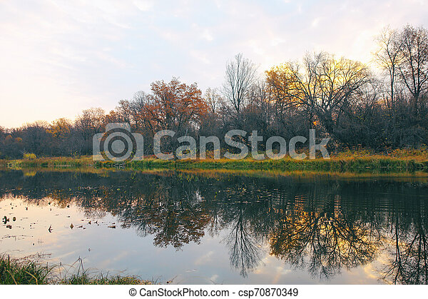 River or lake in early autumn in forest - csp70870349