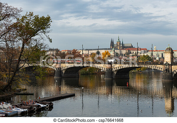 River Vltava and castle of Prague on a sunny day in autumn - csp76641668