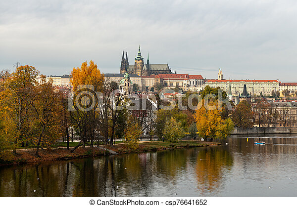 River Vltava and castle of Prague on a sunny day in autumn - csp76641652