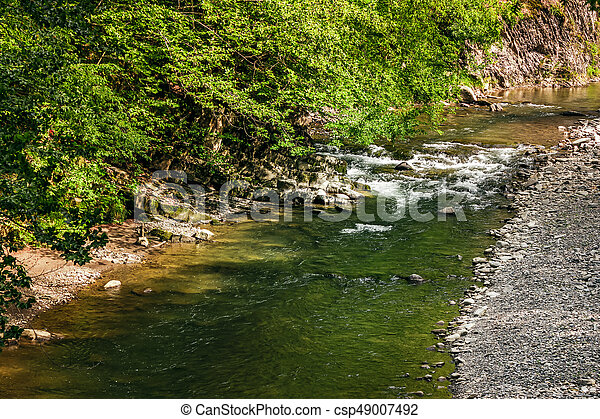 river with rocky shore. view from above - csp49007492