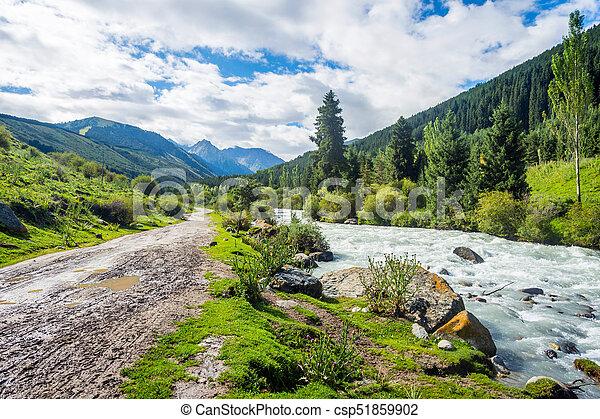 Road and river in Karakol national park, Kyrgyzstan - csp51859902