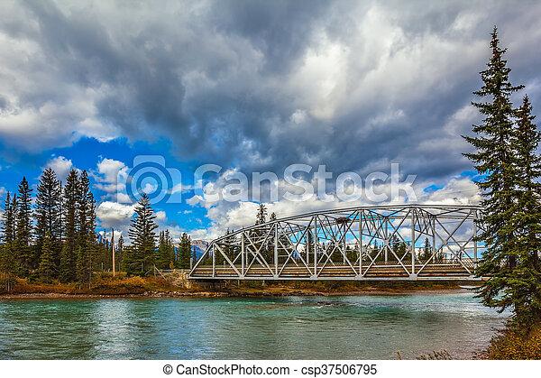 Road bridge over the picturesque river - csp37506795