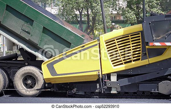 Road construction  Applying new hot asphalt