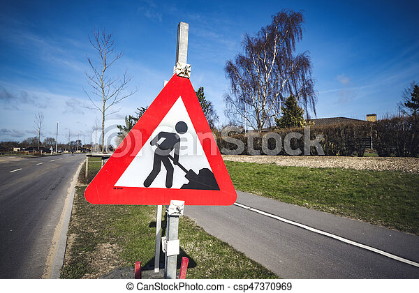 Road construction sign by a roadside - csp47370969