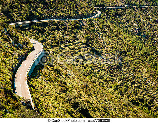 Road in mountains landscape, Spain - csp77063038