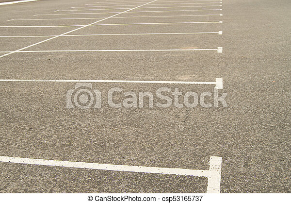Road marking on the asphalted Parking lot without cars - csp53165737