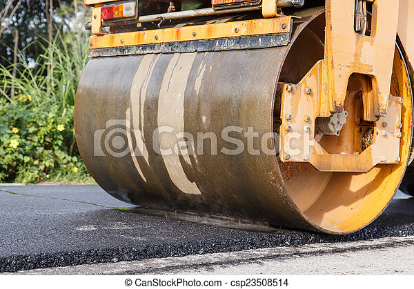 Road roller and asphalt paving machine at construction site - csp23508514