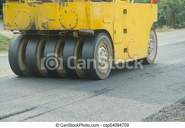 Road roller machine works asphalt road construction