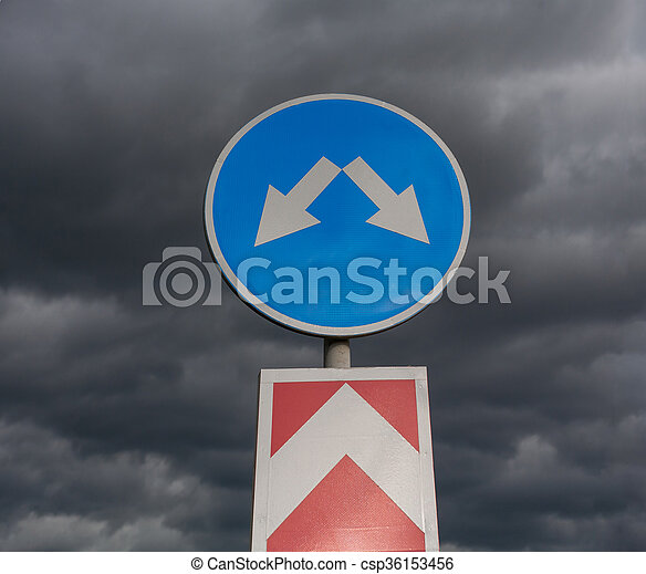 Road sign against cloudy sky - csp36153456