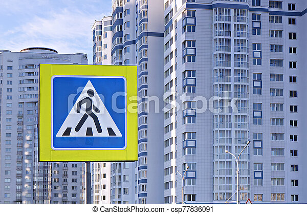 Road sign pedestrian crossing in urban district. - csp77836091