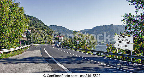 Road sign to green business - csp34615529