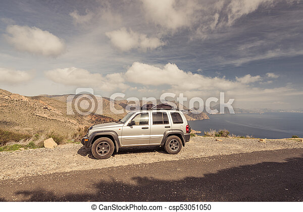 Road trip car in high mountains with lake view - csp53051050