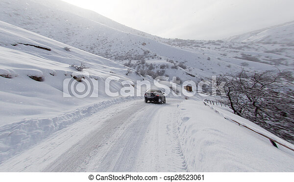road with a car in winter in the mountains - csp28523061