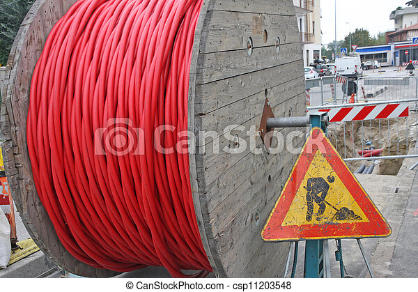 roadworks and a coil of wire with the road sign - csp11203548