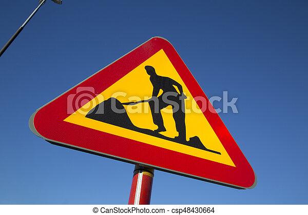 Roadworks Sign in Urban Setting - csp48430664