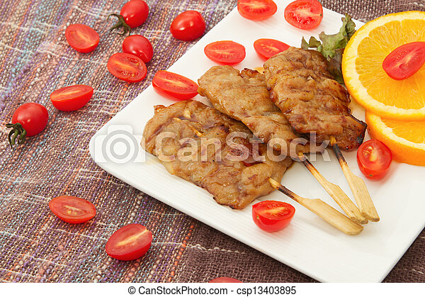 roast pork on a plate with red tomato - csp13403895