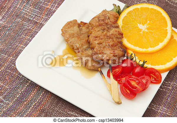 roast pork on a plate with red tomato - csp13403994