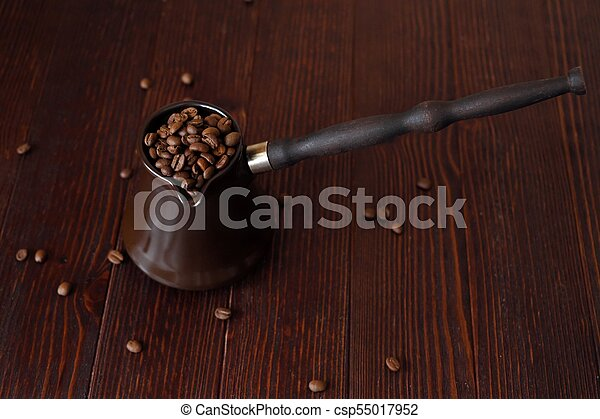 Roasted coffee beans in beautiful copper Turk - csp55017952