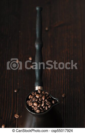 Roasted coffee beans in beautiful copper Turk - csp55017924