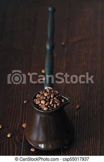 Roasted coffee beans in beautiful copper Turk - csp55017937