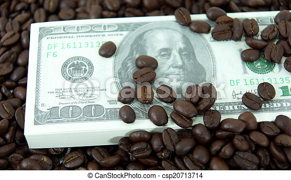 roasted coffee beans on money background. - csp20713714