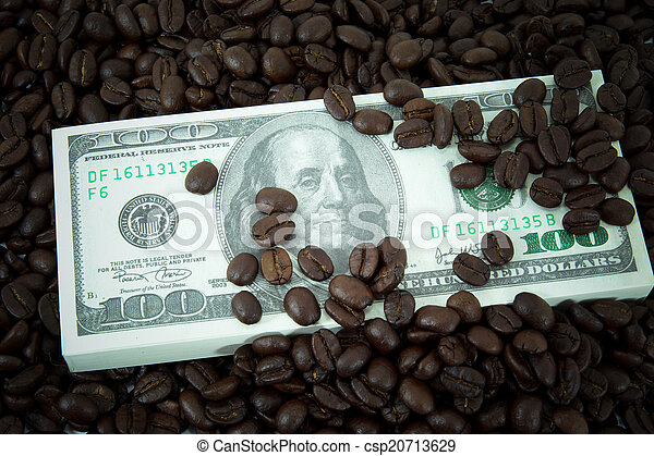 roasted coffee beans on money background. - csp20713629