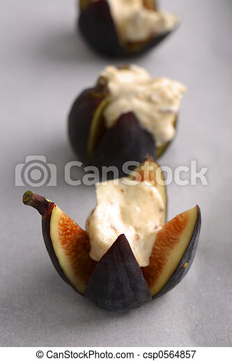 Roasted Figs in Mascarpone Cheese Honey and Hazelnuts - csp0564857
