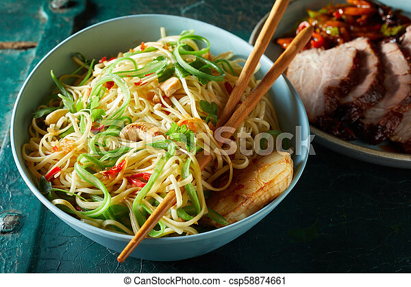 Roasted noodles, garlic and vegetables in a bowl - csp58874661