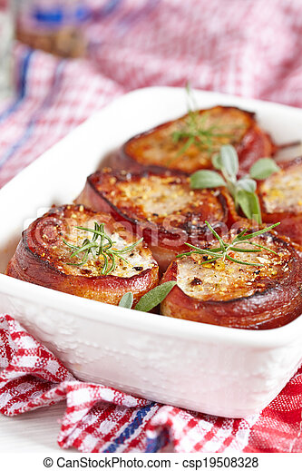 Roasted pork steak wrapped in bacon - csp19508328