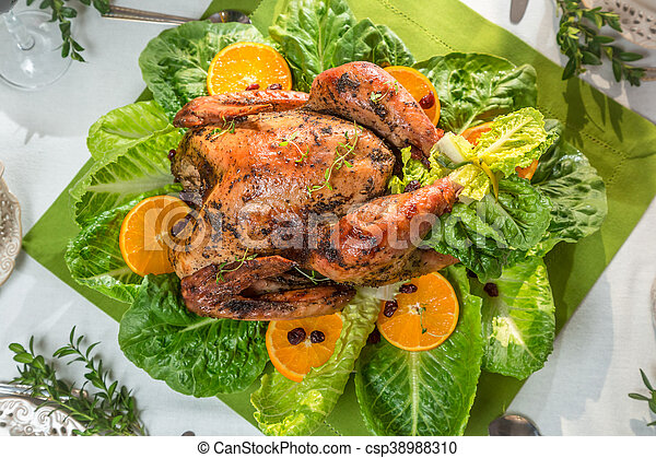 Roasted turkey with orange fruits for thanksgiving - csp38988310