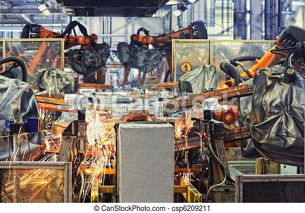 robots in a car factory - csp6209211