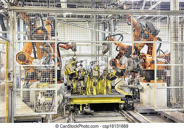 robots in a car factory - csp16131669