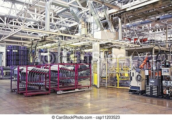 robots in a car factory - csp11203523