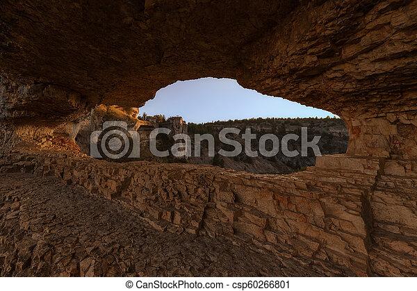 Rock arch at the Rio Lobos canyon - csp60266801