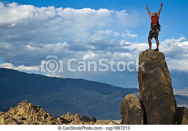 Rock climber nearing the summit. - csp1997213
