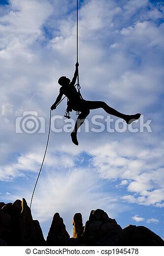Rock climber rappelling. - csp1945478